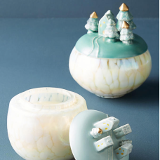 https://www.anthropologie.com/shop/reversed-snowglobe-candle?category=holiday-gifts-all&color=045&quantity=1&size=One%20Size&type=REGULAR