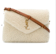https://www.farfetch.com/vn/shopping/women/saint-laurent-monogram-shearling-clutch-item-13162186.aspx?storeid=10191&from=listing&tglmdl=1